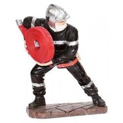 Le Pompier déroulant le tuyau